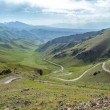 Serpentine mountain road in Kyrgyzstan — Stock Photo