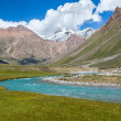 Blue river and snow peaks of Tien Shan mountains — Stock Photo