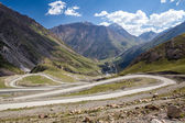 Winding road in Tien Shan mountains — Stock Photo