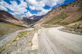 Mountain road going from Barskoon pass — Stock Photo