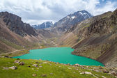 Turquoise wonderful lake in mountains of Tien Shan — Stock Photo