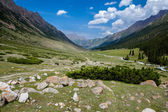 Soil road in mountains of Tien Shan — Stock Photo