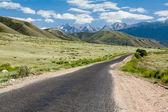 Asphalt road in Tien Shan mountains — Stock Photo