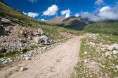 Dirt mountain road. Kyrgyzstan — Stock Photo