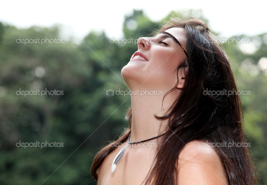 Woman with the face upwards in signal relaxation  Stock Photo #12685343