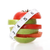 Tomatoes and apple — Stock Photo