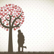 Couple under tree - Imagen vectorial