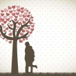 Couple under tree - Stockvectorbeeld