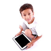 Boy playing on tablet — Stockfoto