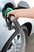 Gas Station Refill Hand and Nozzle — Stock Photo