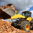Front End Loader Tipping Stone — Stock Photo #41625671