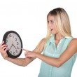 Pretty Lady Pointing to Clock — Stock Photo #43745389