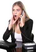 Shocked or Surprised Blonde Office Lady at her Desk — Stock Photo
