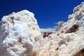 Piles of snow and a train — Stock Photo