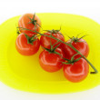 Tomatoes on yellow plate — Stock Photo