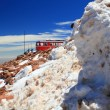 Piles of snow and a train — Stock Photo #15894457