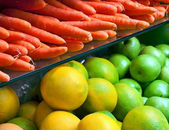 Vegetables and fruit on the counter in the store. — Stock Photo