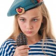 Stock Photo: Portrait of girl in troop beret with grenade in his ha