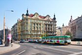 Prague, colorful tram rides along the waterfront. — Stock Photo