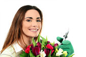 Woman worker with flowers. — Stock Photo