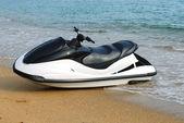 The jet ski parked on the beach. — Stock Photo