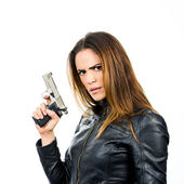 Young beautiful woman holding a gun on white background — Stock Photo