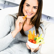 Stock Photo: Womeating salad.