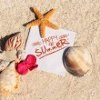 Blank paper beach sand starfish shells summer — Stock Photo #26931981