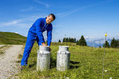 Farmer with milk containers — Stock Photo