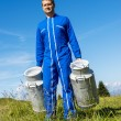 Stockfoto: Farmer with milk containers