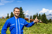 Herdsman and cows — Stock Photo