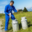 Farmer with milk containers — Stock Photo #33947983