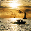 Stock Photo: Sailboat and dishermat sunset