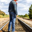Across train tracks — Stockfoto