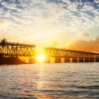Colorful sunset or sunrise with broken bridge — Stock Photo