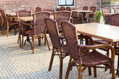 Outdoor summer cafe tables — Stock Photo