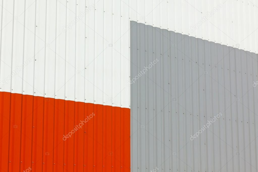 Brightly colored industrial warehouse exterior wall as background — Stock Photo #12645420