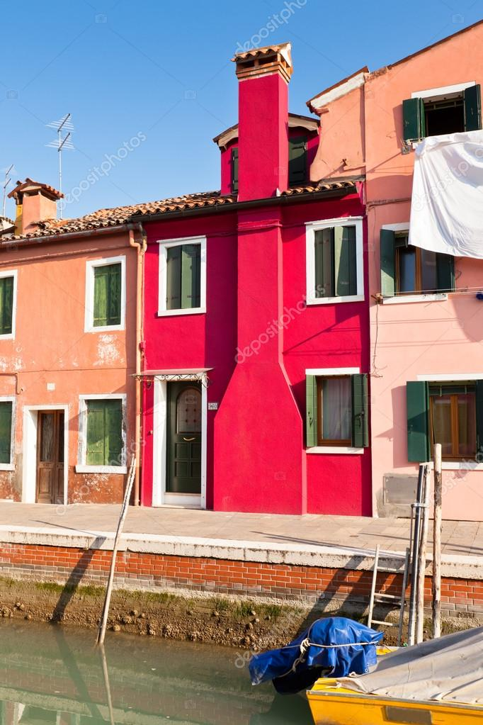 Colorful houses along canal in the island of Burano near Venice, Italy  Stock Photo #12664498