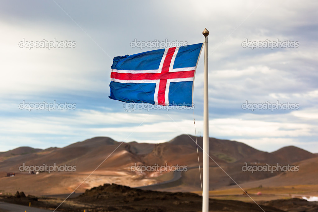 The flag of Iceland waving in the wind on a background of a stormy sky — Stock Photo #12719654