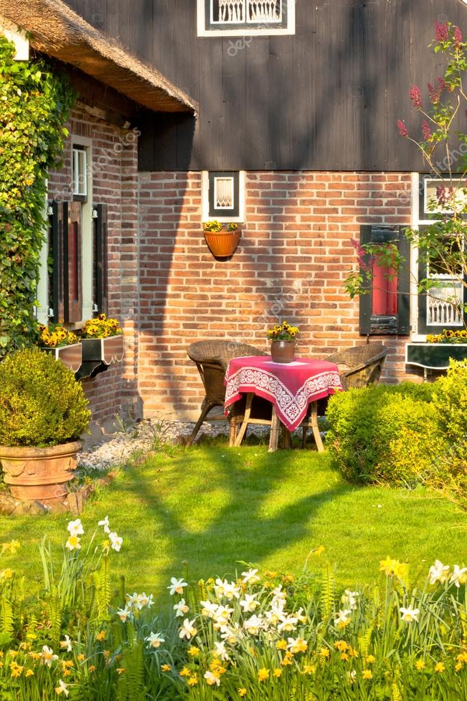 Traditional Dutch house front with garden at spring  Stock Photo #12780807