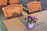 Wicker cafe tables and chairs — Stock Photo