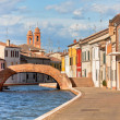 Comacchio, Italy - Canal and colorful houses — Stock Photo