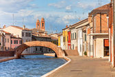 Comacchio, Italy - Canal and colorful houses — ストック写真