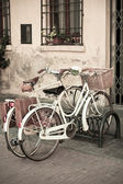 City White Bicycles with Basket — Stock Photo