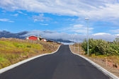Red House and New Asphalt Road in East Iceland — Stock Photo