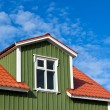 Residential Roof Top under the Bright Blue Sky - Stock Photo