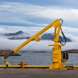 Fishing crane in small seaside Iceland town harbor. — Стоковая фотография
