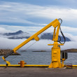 Fishing crane in small seaside Iceland town harbor. — Stok fotoğraf