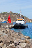 Fishing Trawler and Small Red Lighthouse — Stock Photo