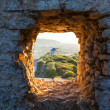 Old Windmill through Window in Fortress Wall — Stock Photo #19503115